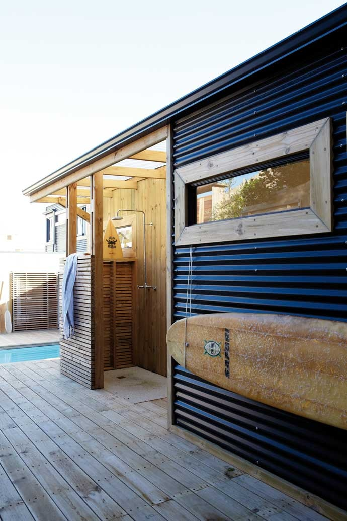 Outside shower house tours corrugated metal house for Beach house ideas uk